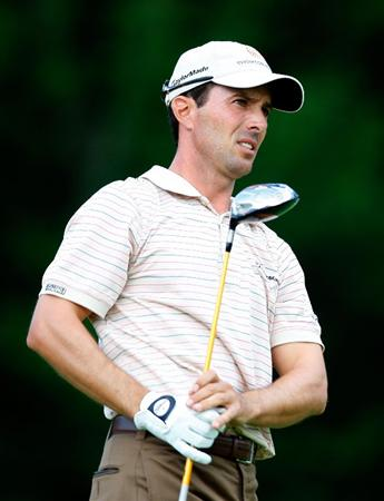 NORTON, MA - AUGUST 29: Mike Weir watches his shot during the first round of the Deutsche Bank Championship at the TPC Boston on August 29, 2008 in Norton, Massachusetts. (Photo by Jim Rogash/Getty Images)