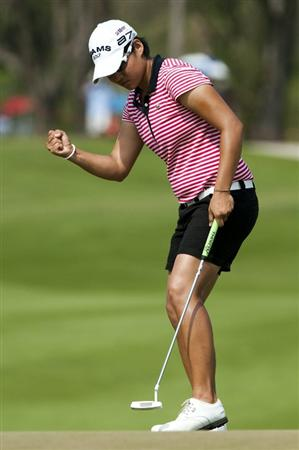 CHON BURI, THAILAND - FEBRUARY 20:  Yani Tseng of Taiwan celebrates a birdie on the 1st green during day four of the LPGA Thailand at Siam Country Club on February 20, 2011 in Chon Buri, Thailand.  (Photo by Victor Fraile/Getty Images)