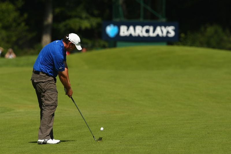 LUSS, SCOTLAND - JULY 10:  Marcus Fraser of Australia hits an approach shot during the Second Round of The Barclays Scottish Open at Loch Lomond Golf Club on July 10, 2009 in Luss, Scotland.  (Photo by Richard Heathcote/Getty Images)