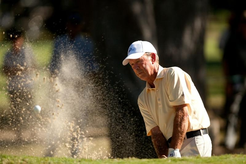 SAN ANTONIO, TX - OCTOBER 29: Larry Nelson follows through on a bunker shot during the first round of the AT&T Championship at Oak Hills Country Club on October 29, 2010 in San Antonio, Texas. (Photo by Darren Carroll/Getty Images)