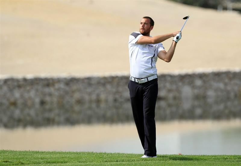 BAHRAIN, BAHRAIN - JANUARY 28:  Oskar Henningsson of Sweden plays his second shot at the 17th hole during the second round of the 2011 Volvo Champions held at the Royal Golf Club on January 28, 2011 in Bahrain, Bahrain.  (Photo by David Cannon/Getty Images)