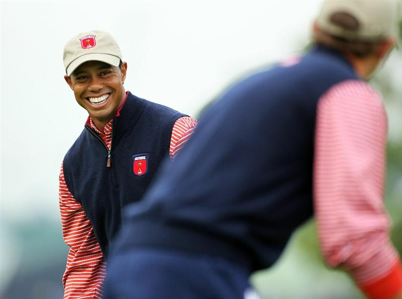 NEWPORT, WALES - SEPTEMBER 30:  Tiger Woods of the USA chats with Dustin Johnson (R) during a practice round prior to the 2010 Ryder Cup at the Celtic Manor Resort on September 30, 2010 in Newport, Wales.  (Photo by Andy Lyons/Getty Images) *** BESTPIX ***