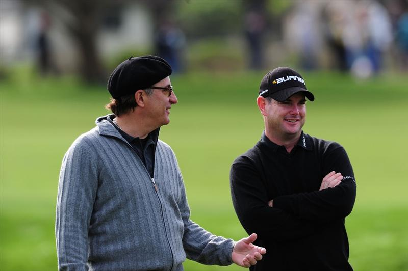 PEBBLE BEACH, CA - FEBRUARY 11:  (L-R) Actor Andy Garcia and Rory Sabbatini of South Africa share a laugh during round one of the AT&T Pebble Beach National Pro-Am at Monterey Peninsula Country Club Shore Course on February 11, 2010 in Pebble Beach, California.  (Photo by Stuart Franklin/Getty Images)