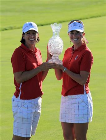 SUGAR GROVE, IL - AUGUST 23: Paula Creamer and Juli Inkster of the USA with the trophy after the Sunday singles matches at the 2009 Solheim Cup Matches, at the Rich Harvest Farms Golf Club on August 23, 2009 in Sugar Grove, Ilinois (Photo by David Cannon/Getty Images)
