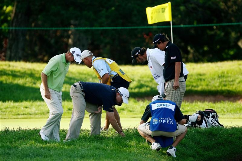 OAKVILLE, ONTARIO - JULY 26 : Jerry Kelly, Jason Duffner and caddies search for Scott Verplunk's ball in the rough on the 10th green during round three of the RBC Canadian Open at Glen Abbey Golf Club on July 26, 2009 in Oakville, Ontario, Canada.  (Photo by Chris McGrath/Getty Images)