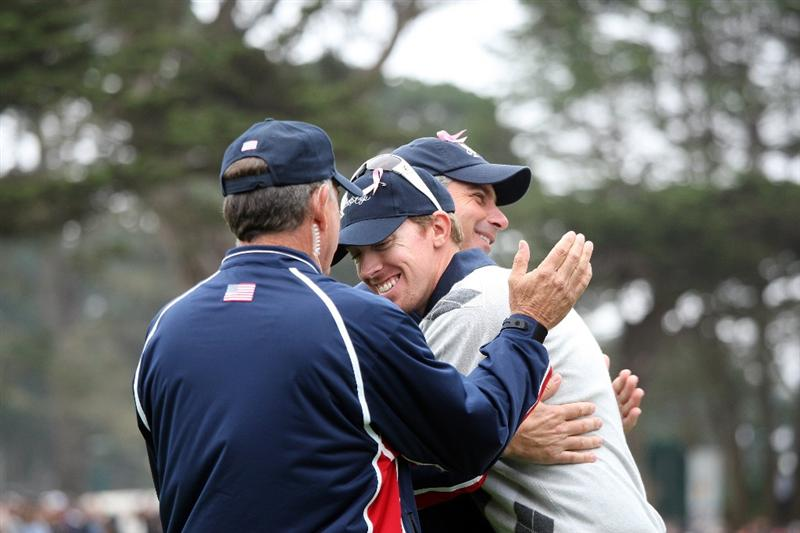 SAN FRANCISCO - OCTOBER 10:  Hunter Mahan of the USA Team celebrates halving his match with Stewart Cink against Singh and Allenby at the par 5, 18th hole with Fred Couples Captain of the USA Team and Jay Haas the assistant captain during the Day Three Morning Fousomes Matches in The Presidents Cup at Harding Park Golf Course on October 10, 2009 in San Francisco, California  (Photo by David Cannon/Getty Images)