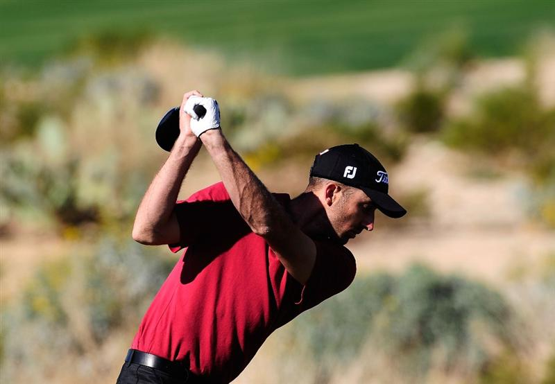 MARANA, AZ - FEBRUARY 16:  Geoff Ogilvy of Australia drives during the second practice round prior to the start of the Accenture Match Play Championship at the Ritz-Carlton Golf Club on February 16, 2010 in Marana, Arizona.  (Photo by Stuart Franklin/Getty Images)