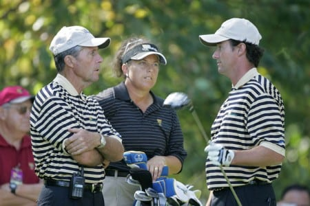Captain Gary Player of the International team, left, talks with Mark Hensby with caddie Fanny Sunneson in the rear during a practice round at The Presidents Cup at Robert Trent Jones Golf Club in Prince William County, Virginia on September 21, 2005.Photo by Stan Badz/PGA TOUR/WireImage.com