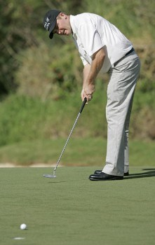 Jason Bohn sinks a putt on the fourth green during the third round of the PGA TOUR's Mercedes Open, January 7, 2006 at the Plantation Course on Kapalua Resort in Kapalua, Maui, Hawaii.Photo by Marco Garcia/PGA TOUR/WireImage.com