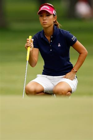 BETHLEHEM, PA - JULY 11:  Momoko Ueda of Japan lines up a putt on the 13th hole during the third round of the 2009 U.S. Women's Open at Saucon Valley Country Club on July 11, 2009 in Bethlehem, Pennsylvania.  (Photo by Chris Graythen/Getty Images)
