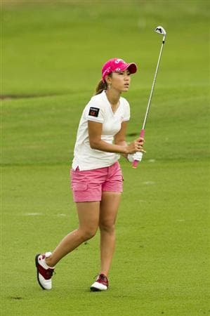 CHON BURI, THAILAND - FEBRUARY 21:  Momoko Ueda of Japan plays an approach shot to the 2nd green during the final round of the Honda PTT LPGA Thailand at Siam Country Club on February 21, 2010 in Chon Buri, Thailand.  (Photo by Victor Fraile/Getty Images)