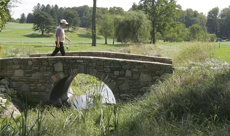 TIMONIUM, MD - OCTOBER 01:  Fred Funk crosses a bridge during the first round of the Constellation Energy Senior Players Championship at Baltimore Country Club/Five Farms (East Course) held on October 1, 2009 in Timonium, Maryland  (Photo by Michael Cohen/Getty Images)