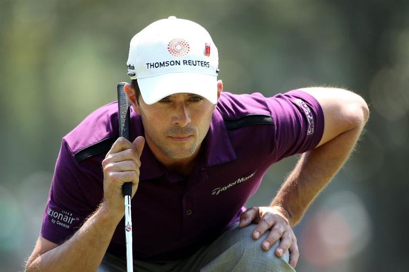 AUGUSTA, GA - APRIL 08:  Mike Weir of Canada lines up a putt on the first green during the second round of the 2011 Masters Tournament at Augusta National Golf Club on April 8, 2011 in Augusta, Georgia.  (Photo by Andrew Redington/Getty Images)