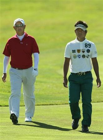 PEBBLE BEACH, CA - JUNE 16:  (L-R) Toru Taniguchi of Japan and Hiroyuki Fujita of Japan walk together during a practice round prior to the start of the 110th U.S. Open at Pebble Beach Golf Links on June 16, 2010 in Pebble Beach, California.  (Photo by Jeff Gross/Getty Images)