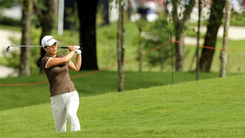 KUALA LUMPUR, MALAYSIA - OCTOBER 24:  Meena Lee of Korea Republic watching her 2nd tee shot on the 1st hole during the Final Round of the Sime Darby LPGA on October 24, 2010 at the Kuala Lumpur Golf and Country Club in Kuala Lumpur, Malaysia. (Photo by Stanley Chou/Getty Images)