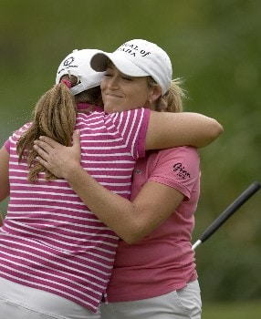 PORTLAND, OR - AUGUST 24: Cristie Kerr (R) is hugged by Kelli Kuehne after finishing her final round at 13 under par at the LPGA Safeway Classic at the Columbia Edgewater Country Club on August 24, 2008 in Portland, Oregon. Kerr went on to win in a playoff with a birdie at the 18th hole. (Photo by Steven Gibbons/Getty Images)