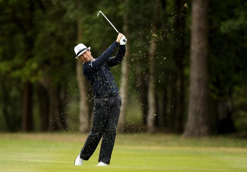 VIRGINIA WATER, ENGLAND - MAY 27:  Steve Webster of England hits an approach shot during the second round of the BMW PGA Championship at the Wentworth Club on May 27, 2011 in Virginia Water, England.  (Photo by Ian Walton/Getty Images)