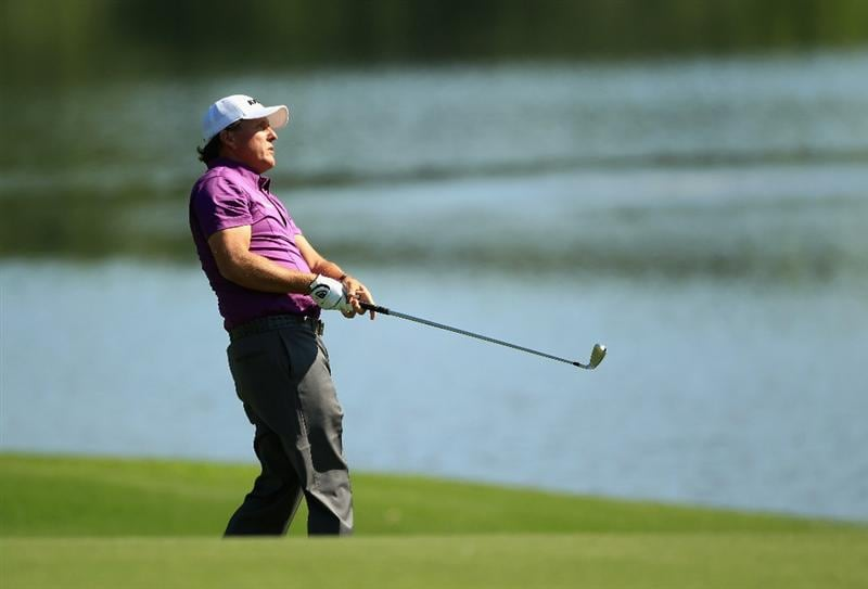CHARLOTTE, NC - MAY 05:  Phil Mickelson watches a shot on the 15th hole during the first round of the Wells Fargo Championship at Quail Hollow Club on May 5, 2011 in Charlotte, North Carolina.  (Photo by Streeter Lecka/Getty Images)