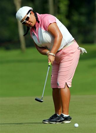 KUALA LUMPUR, MALAYSIA - OCTOBER 23: Christina Kim of USA putts on the 3rd hole during Round Two of the Sime Darby LPGA on October 23, 2010 at the Kuala Lumpur Golf and Country Club in Kuala Lumpur, Malaysia. (Photo by Stanley Chou/Getty Images)