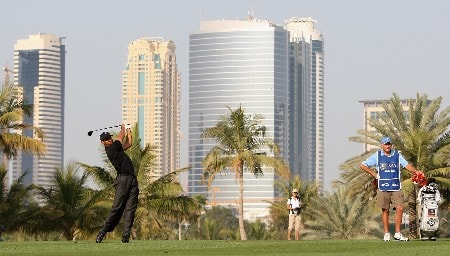 DUBAI, UNITED ARAB EMIRATES - JANUARY 31:  Tiger Woods of the USA in action on the 14th fairway during the first round of the Dubai Desert Classic on the Majlis Course held at the Emirates Golf Club on January 31, 2008 in Dubai,United Arab Emirates.  (Photo by Ross Kinnaird/Getty Images)