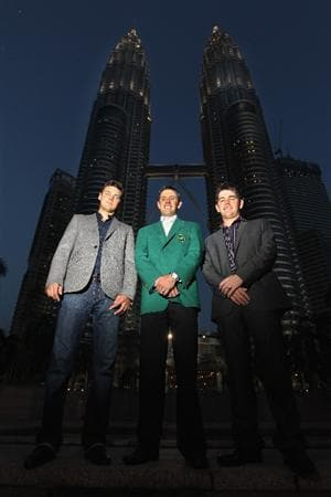 KUALA LUMPUR, MALAYSIA - APRIL 13:  Martin Kaymer of Germany, Charl Schwartzel and Louis Oosthuizen of South Africa poses for photos outside the Petronas Towers prior to the Maybank Malaysian Open at Kuala Lumpur Golf & Country Club on April 13, 2011 in Kuala Lumpur, Malaysia.  (Photo by Ian Walton/Getty Images)