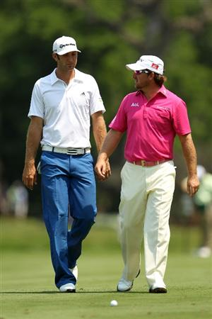 PONTE VEDRA BEACH, FL - MAY 12:  (L-R) Dustin Johnson and Graeme McDowell of Northern Ireland walk across the 15th hole during the first round of THE PLAYERS Championship held at THE PLAYERS Stadium course at TPC Sawgrass on May 12, 2011 in Ponte Vedra Beach, Florida.  (Photo by Mike Ehrmann/Getty Images)