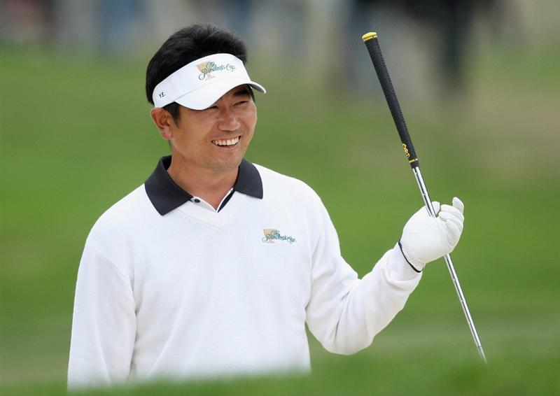 SAN FRANCISCO - OCTOBER 10:  Y. E. Yang of the International team smiles in reaction to his shot from the bunker that went through the legs of Tiger Woods on the ninth hole during the Day Three Afternoon Fourball Matches in The Presidents Cup at Harding Park Golf Course on October 10, 2009 in San Francisco, California  (Photo by David Cannon/Getty Images)