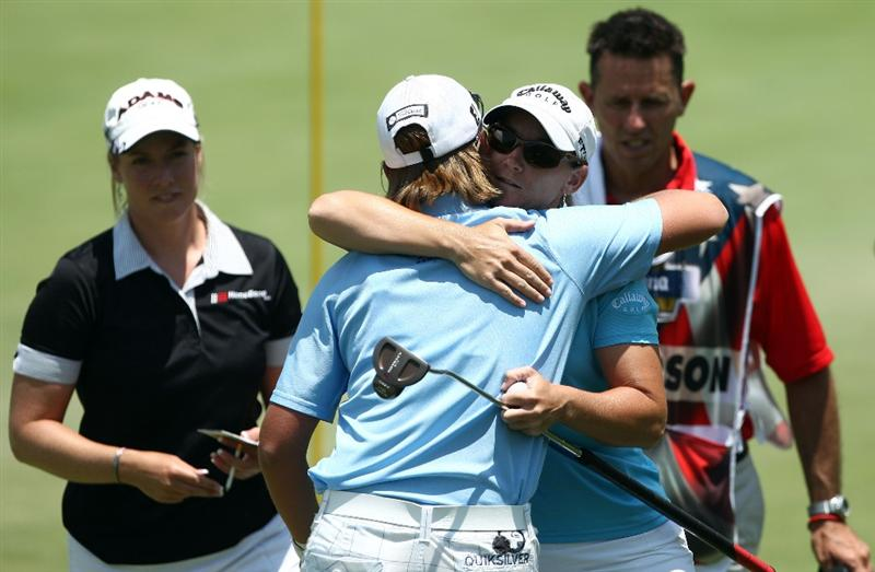 MORELIA, MEXICO- APRIL 24:  Kristy McPherson hugs Katherine Hull of Australia on the 18th hole during the second round of the Corona Championship at the Tres Marias Residential Golf Club on April 24, 2009 in Morelia, Michoacan, Mexico.  Kristy McPherson finished the day at 10-under par and a share of the lead after two rounds. (Photo by Donald Miralle/Getty Images)