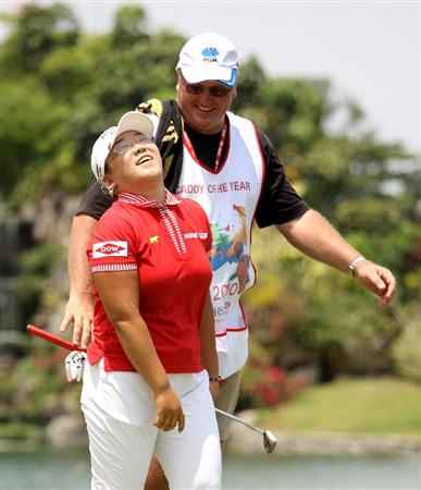 SINGAPORE - FEBRUARY 28:  Jiyai Shin of South Korea and her caddie Dean Herden during the final round of the HSBC Women's Champions at the Tanah Merah Country Club on February 28, 2010 in Singapore.  (Photo by Ross Kinnaird/Getty Images)