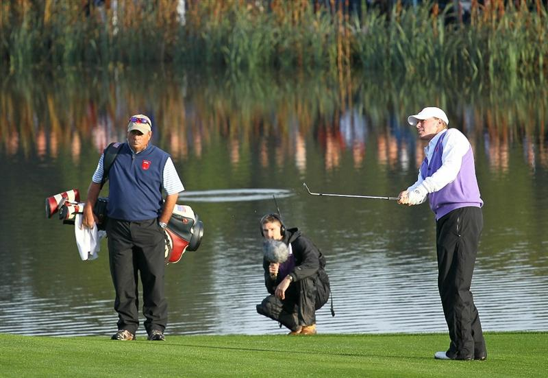 NEWPORT, WALES - OCTOBER 02:  Steve Stricker of the USA chips in on the 12th hole during the rescheduled Morning Fourball Matches during the 2010 Ryder Cup at the Celtic Manor Resort on October 2, 2010 in Newport, Wales.  (Photo by Andy Lyons/Getty Images)
