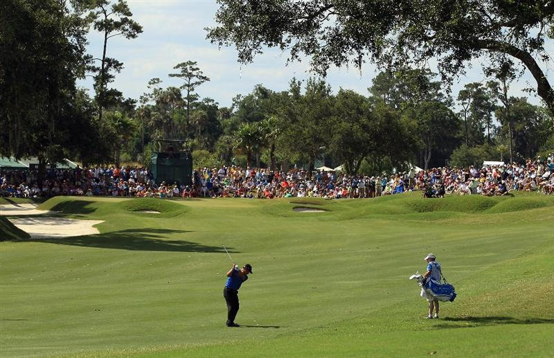 PONTE VEDRA BEACH, FL - MAY 15:  K.J. Choi of South Korea hits an approach shot on the ninth hole during the final round of THE PLAYERS Championship held at THE PLAYERS Stadium course at TPC Sawgrass on May 15, 2011 in Ponte Vedra Beach, Florida.  (Photo by Streeter Lecka/Getty Images)