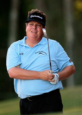 LAKE BUENA VISTA, FL - NOVEMBER 11:  Tim Herron plays a shot on the 18th hole during the first round of the Children's Miracle Network Classic at the Disney Palm and Magnolia courses on November 11, 2010 in Lake Buena Vista, Florida.  (Photo by Sam Greenwood/Getty Images)
