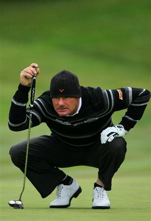 PEBBLE BEACH, CA - JUNE 18:  Alex Cejka of Germany lines up a putt on the second green during the second round of the 110th U.S. Open at Pebble Beach Golf Links on June 18, 2010 in Pebble Beach, California.  (Photo by Donald Miralle/Getty Images)