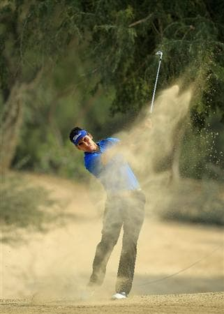 DUBAI, UNITED ARAB EMIRATES - FEBRUARY 11:  Rafael Cabrera-Bello of Spain in the desert  for his second shot at the 14th hole during the second round of the 2011 Omega Dubai Desert Classic on the Majilis Course at the Emirates Golf Club on February 11, 2011 in Dubai, United Arab Emirates.  (Photo by David Cannon/Getty Images)