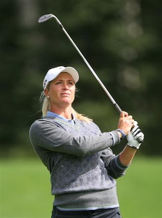 CALGARY, AB - SEPTEMBER 04 : Suzann Pettersen of Norway watches her third shot on the ninth hole during the second round of the Canadian Women's Open at Priddis Greens Golf & Country Club on September 4, 2009 in Calgary, Alberta, Canada. (Photo by Hunter Martin/Getty Images)
