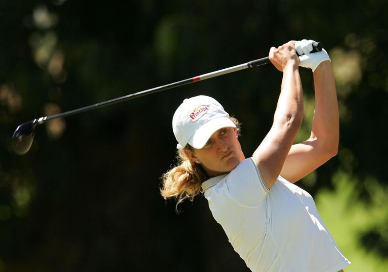 MELBOURNE, AUSTRALIA - MARCH 13:  Giulia Sergas of Italy hits an approach shot on the 12th hole during day three of the Women's Australian Open at The Commonwealth Golf Club on March 13, 2010 in Melbourne, Australia.  (Photo by Scott Barbour/Getty Images)