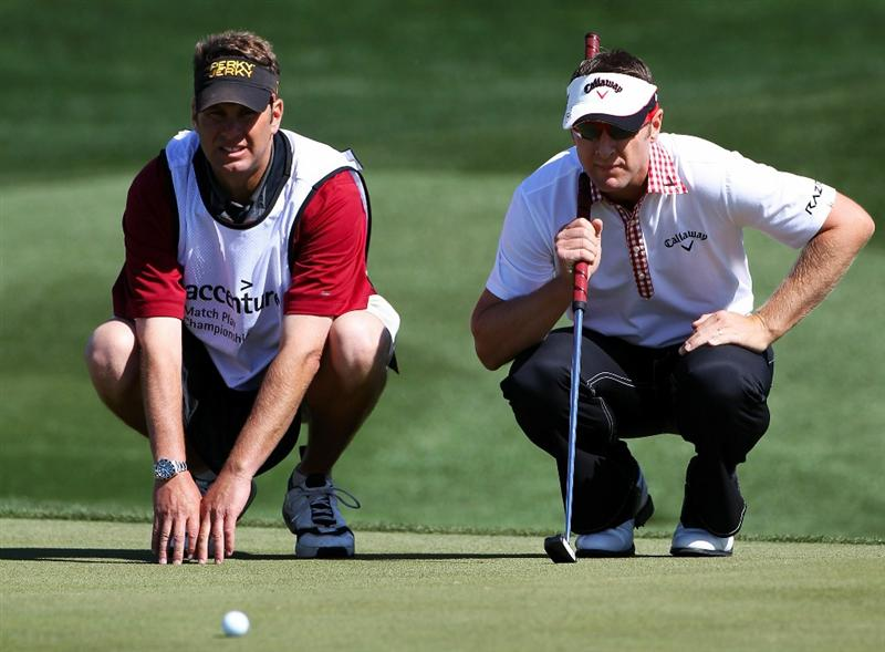 MARANA, AZ - FEBRUARY 23:  Brandan Jones of Australia (R) lines up a putt with the help of his caddie on the third green during the first round of the Accenture Match Play Championship at the Ritz-Carlton Golf Club on February 23, 2011 in Marana, Arizona.  (Photo by Sam Greenwood/Getty Images)