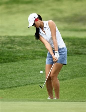 RANCHO MIRAGE, CA - APRIL 02:  Michelle Wie chips onto the green on the second hole during the third round of the Kraft Nabisco Championship at Mission Hills Country Club on April 2, 2011 in Rancho Mirage, California.  (Photo by Stephen Dunn/Getty Images)