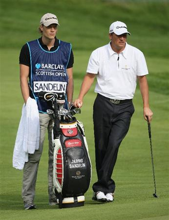 LUSS, UNITED KINGDOM - JULY 09:  Jarmo Sandelin of Sweden waits to play on the 11th hole with his caddy during the First Round of The Barclays Scottish Open at Loch Lomond Golf Club on July 09, 2009 in Luss, Scotland. (Photo by Andrew Redington/Getty Images)