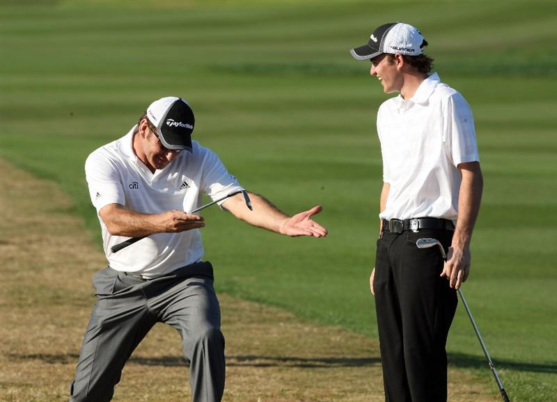 CHAMPIONS GATE, FL - DECEMBER 06: Nick Faldo of England salutes his son Matthew Faldo after Matthew had secured a tap-in birdie at the 18th hole during the first round of the Del Webb Father Son Challenge on the International Course at Champions Gate Golf Club on December 6, 2008 in Champions Gate, Florida.  (Photo by David Cannon/Getty Images)
