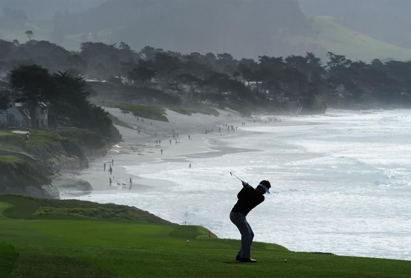 PEBBLE BEACH, CA - FEBRUARY 12:  Ryuji Imada of Japan plays a shot on the nineth hole during round two of the AT&T Pebble Beach National Pro-Am at Pebble Beach Golf Links on February 12, 2010 in Pebble Beach, California.  (Photo by Stuart Franklin/Getty Images)