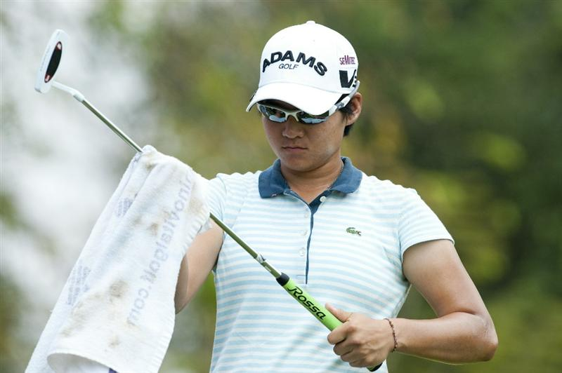 CHON BURI, THAILAND - FEBRUARY 18:  Yani Tseng of Taiwan cleans her club on the 3rd tee during day two of the LPGA Thailand at Siam Country Club on February 18, 2011 in Chon Buri, Thailand.  (Photo by Victor Fraile/Getty Images)