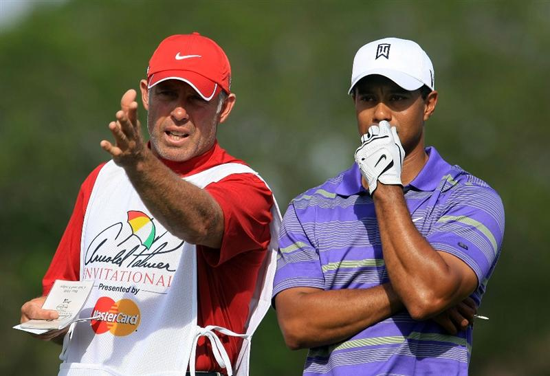 ORLANDO, FL - MARCH 28:  Tiger Woods chats with his caddie Steve Williams on the 14th tee during the third round of the Arnold Palmer Invitational at the Bay Hill Club & Lodge on March 28, 2009 in Orlando, Florida.  (Photo by Scott Halleran/Getty Images)