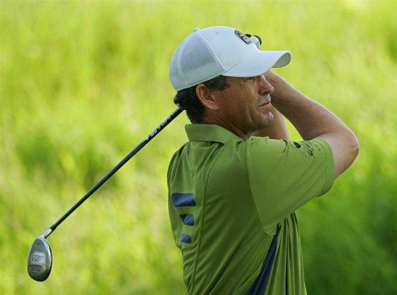 SILVIS, IL - JULY 11:  Lee Janzen of the USA watches his tee shot during the continuation of the second round of the John Deere Classic at TPC Deere Run held on July 11, 2009 in Silvis, Illinois.  (Photo by Michael Cohen/Getty Images)