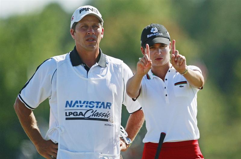 PRATTVILLE, AL - OCTOBER 3:  Lorena Ochoa of Mexico talks with her caddie on the 10th tee during third round play in the Navistar LPGA Classic at the Robert Trent Jones Golf Trail at Capitol Hill on October 3, 2009 in  Prattville, Alabama.  (Photo by Dave Martin/Getty Images)