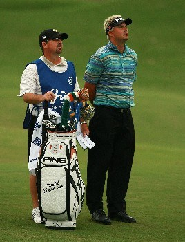 PORT SAINT LUCIE, FL - OCTOBER 25:  Daniel Chopra and his caddie Mitch Knox check the wind from the fairway on the ninth hole during the Ginn Sur Mer Classic at Tesoro on October 25, 2007 in Port Saint Lucie, Florida.  (Photo by Doug Benc/Getty Images)