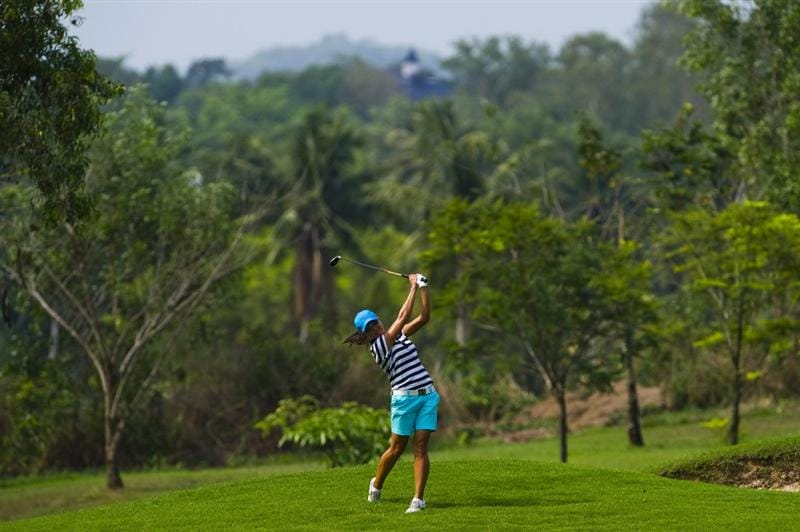 CHON BURI, THAILAND - FEBRUARY 19:  Thidapa Suwannapura of Thailand plays her second shot on the 9th hole during round two of the Honda LPGA Thailand at the Siam Country Club on February 19, 2010 in Chon Buri, Thailand.  (Photo by Victor Fraile/Getty Images)