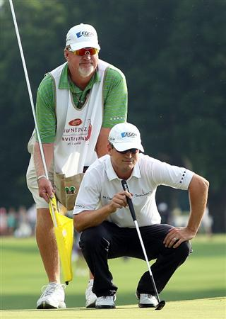 FT. WORTH, TX - MAY 30:  Zach Johnson lines up a putt with his caddie Damon Green on the 18th green during the final round of the 2010 Crowne Plaza Invitational at the Colonial Country Club on May 30, 2010 in Ft. Worth, Texas.  (Photo by Scott Halleran/Getty Images)