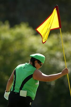 RANCHO MIRAGE, CA - APRIL 02:  Christina  Kim places the flagstick on the fifth hole during the first round of the Kraft Nabisco Championship at Mission Hills Country Club on April 2, 2009 in Rancho Mirage, California.  (Photo by Stephen Dunn/Getty Images)