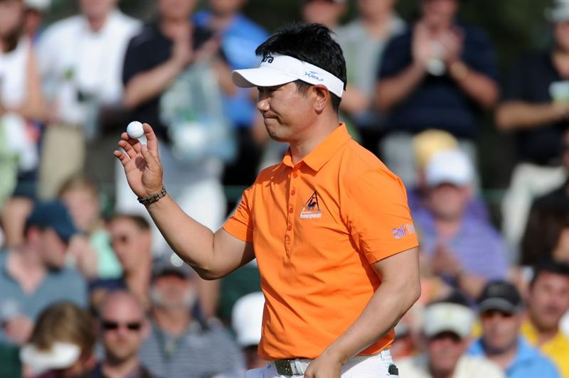 AUGUSTA, GA - APRIL 07:  Y.E. Yang of South Korea waves to fans on the 18th hole during the first round of the 2011 Masters Tournament at Augusta National Golf Club on April 7, 2011 in Augusta, Georgia.  (Photo by Harry How/Getty Images)